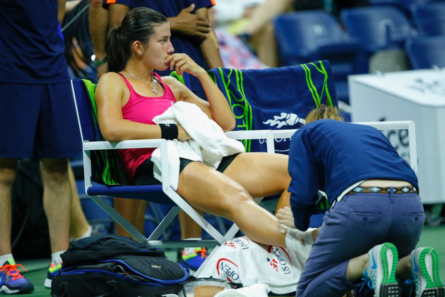 Anastasija Sevastova of Latvia receives medical assistance as she plays against Caroline Wozniacki of Denmark  during their 2016 US Open Women's Singles match at the USTA Billie Jean King National Tennis Center in New York on September 6, 2016. / AFP PHOTO / KENA BETANCUR